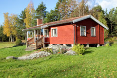 Red scandinavian  summer cottage Stock Images