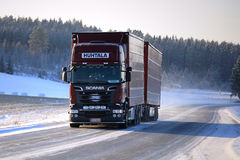 Red Scania on Icy Winter Road Royalty Free Stock Photography