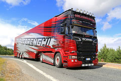 Red Scania R 730 Semi of Valcarenghi on the Road Stock Photo