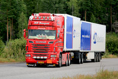 Red Scania Refrigerated Transport Truck in Motion Royalty Free Stock Image