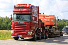Red Scania Semi Transports Construction Machinery Uphill Royalty Free Stock Images