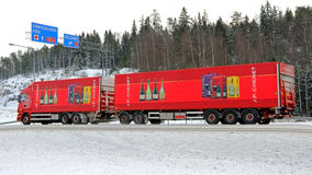Red Scania Truck with Wine Trailers on the Road. FORSSA, FINLAND - FEBRUARY 2, 2014: Scania truck with wine trailers on the road. J.P. J.P. Chenet Reserve wines Royalty Free Stock Images