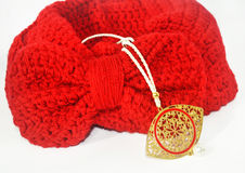 Red scarf with bow and byzantine gold necklace Royalty Free Stock Image