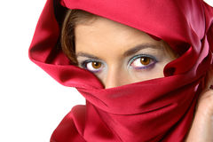Red scarf covered woman. Woman with red scarf covering whole face except for eyes royalty free stock image
