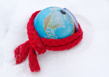 Red scarf earth globe sphere winter snow concept. Red scarf on earth globe sphere in winter snow snowbank. care of mother earth concept stock photography