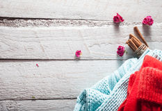Red scarf and hat with cinnamon. winter mood on Valentine's Day Stock Photos