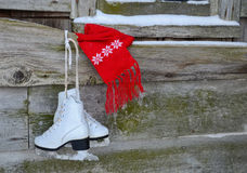 Red scarf with ice skates Stock Images