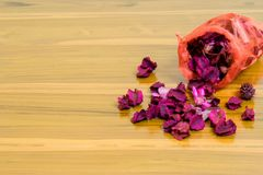 Red scented bag on wooden table give good smell and deep sleeping Royalty Free Stock Images
