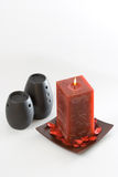Red Scented Candle. And black ceramic aromatic oil burners isolated on white background Stock Photography