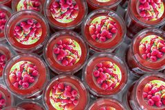 Red scented candles with raspberry flavor on the shop counter stock photo
