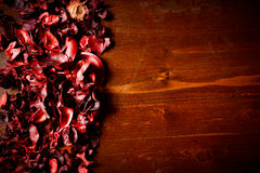 Red scented potpourri on dark wooden table. Copy space royalty free stock images