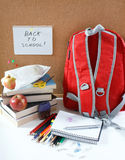 A red school back pack royalty free stock images