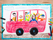 Red school bus with happy children inside