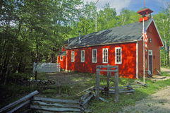 Red schoolhouse in rustic setting, MI Royalty Free Stock Photos