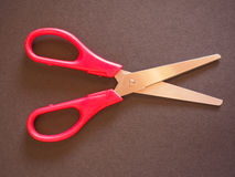 Red scissors. With cutting lame open over black background Stock Photo