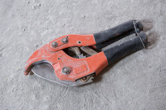 Red scissors for cutting plastic pipe stock images