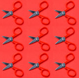 Red scissors on red background in pop art style. Concept with red scissors on red background in pop art style Stock Photos