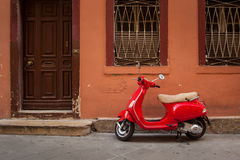Red scooter. In front of old house Royalty Free Stock Photo