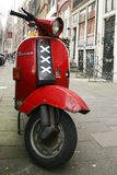 Red scooter in Amsterdam - The Netherlands stock photo