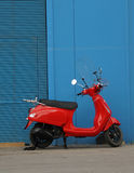 Red scooter Stock Images