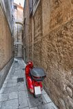 Red scooter in a narrow street, Croatia Royalty Free Stock Photo