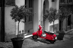 Red scooter parked in narrow old street of Rome. One of the most popular transport in Italy, vintage Vespa stock photos