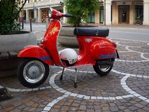 Red scooter parked on a street in Mestre, Italy. Red scooter parked on a street in Mestre, Metropolitan City of Venice, Italy Royalty Free Stock Images