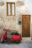Red scooter in the street stock photo
