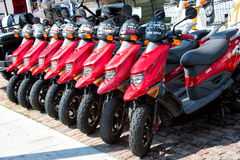 Red scooters, motorcycles for sale or hire, Key West, Florida Stock Photo