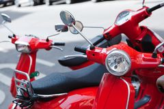Red scooters parking on the streets royalty free stock images