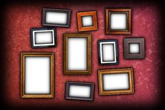 Red scratched wall with frames Stock Photos