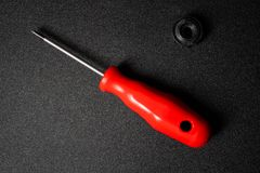 Red screwdriver with the detail on the black background stock images
