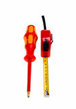 Red screwdriver and a red tape measure. Isolated on white background Royalty Free Stock Photos