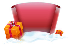 Red scroll and gift boxes in snow. Template for greeting Christmas card Royalty Free Stock Photos