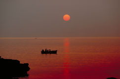 Red sea. Sunset in Milos Stock Images