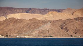 Red sea and border between Egypt and Israel. This is the border fence between Egypt in the Sinai Desert and Israel in the Negev Desert. The coastline is on the royalty free stock images