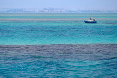 Red Sea, clean blue water, boat, city skyline, Egypt Royalty Free Stock Images