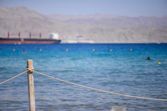 Red sea coast with fence Royalty Free Stock Photo