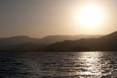 Red Sea Coast Setting Sun. Sun setting over a mountain range on the Red Sea coast Stock Photos