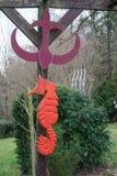 The red sea horse on an anchor. In a garden Royalty Free Stock Photos
