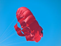 Red sea parachute. Floating on blue sky background Stock Photo