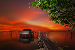 Sunset on the lake and fiery sky Royalty Free Stock Photo