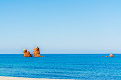 Red sea stack in Cea beach. Sardinia Royalty Free Stock Images