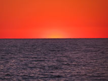 Red sea sunset. Blue sea on the background of the setting sun Stock Images