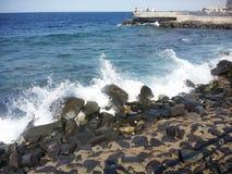 Red sea. Waves shore rocks stock photos