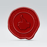 Red sealing wax approved stamp print. Glossy red sealing stamp round seal with thumb up and quality guarantee inscription hanging in the air Royalty Free Stock Image