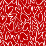 Red seamless with doodle hearts Stock Photos