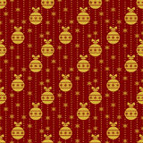 Red seamless pattern with gold Christmas balls. Stock Photos