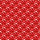 Red seamless snowflake pattern. Christmas vector background.   Stock Photos