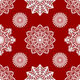 Red seamless snowflake pattern. White snowflakes on red background. Vector illustration. Red seamless snowflake pattern. White snowflakes on red background Stock Illustration
